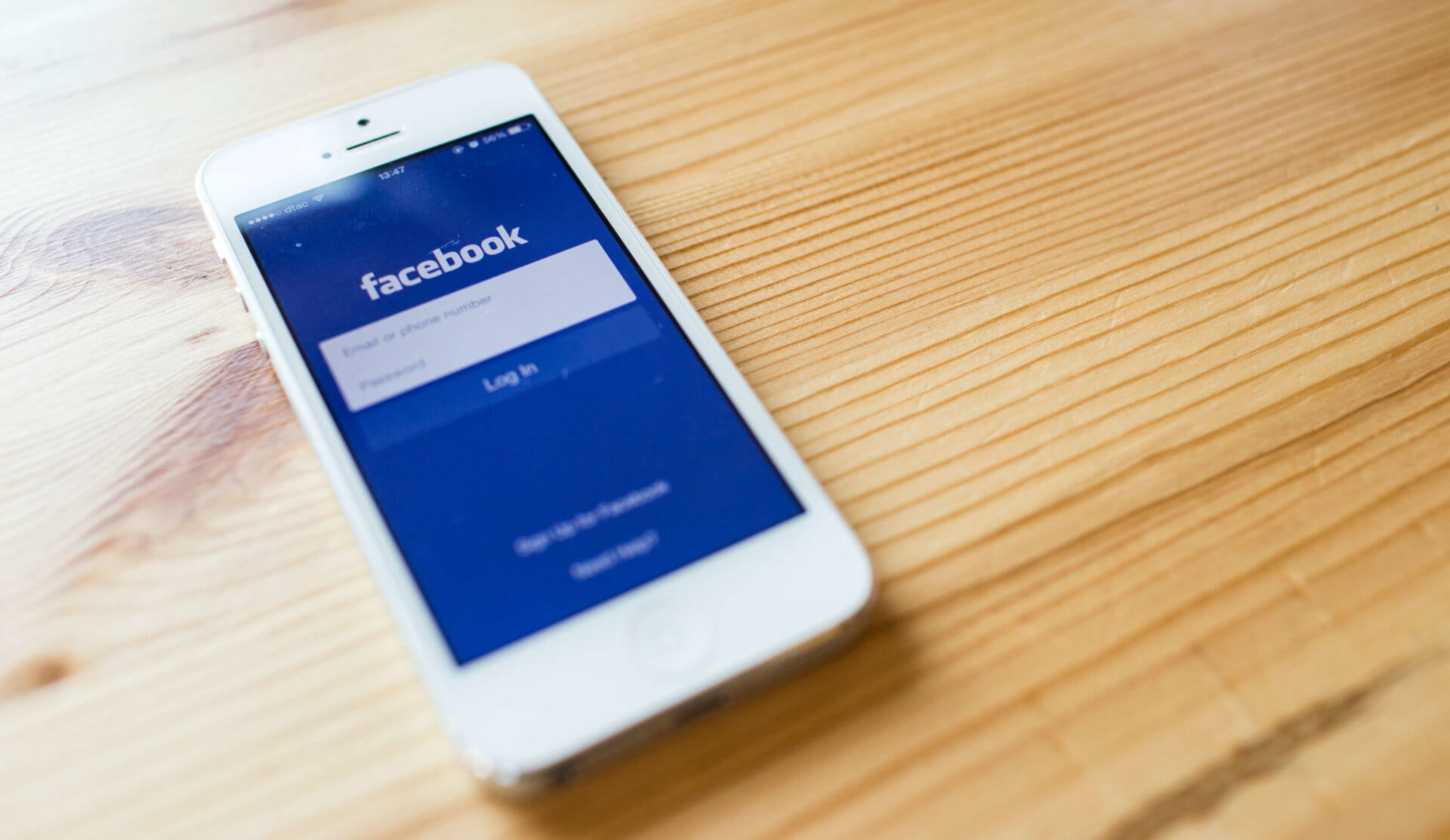 Facebook application sign in page on Apple iPhone 5. Facebook is largest and most popular social networking site in the world
